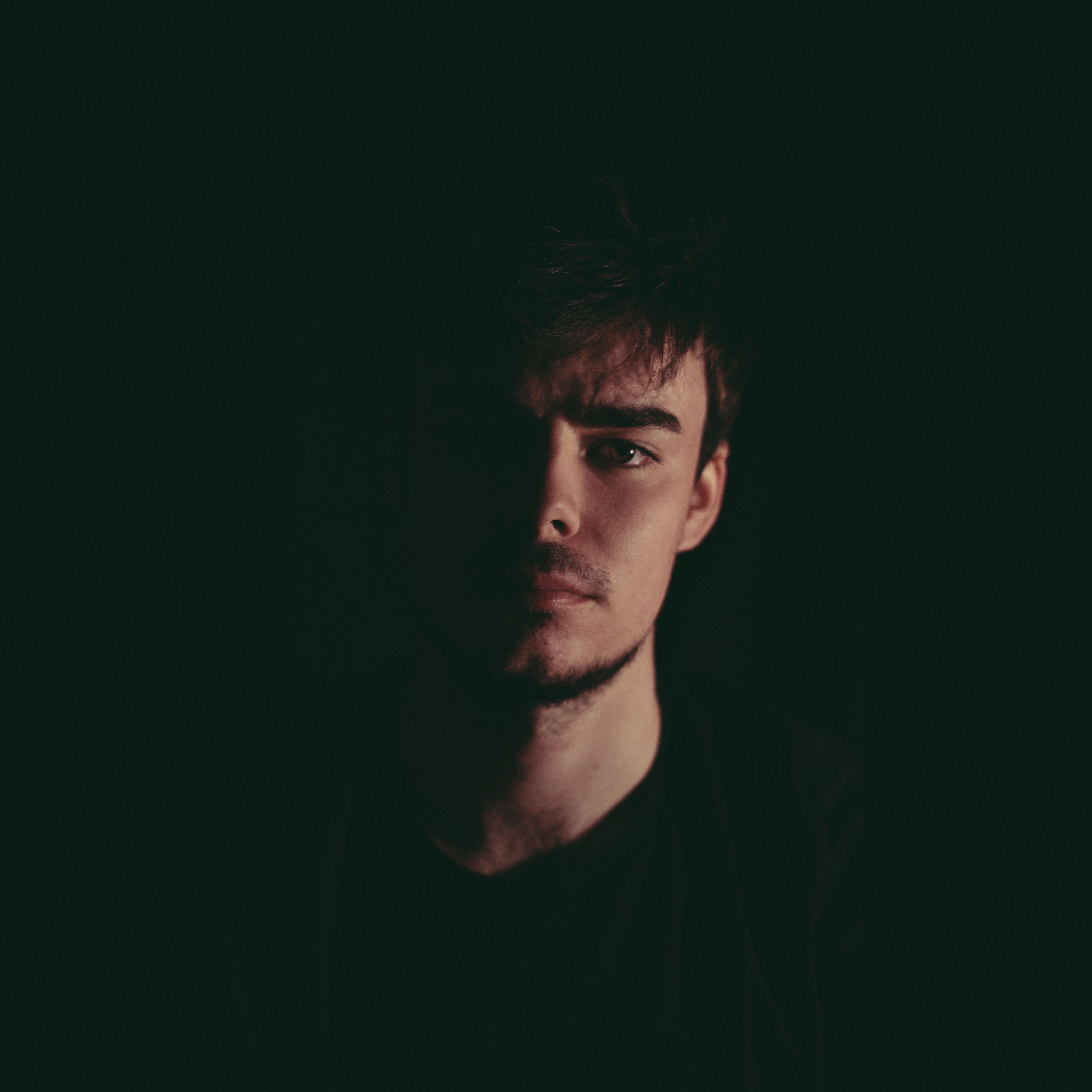 man standing on dark area