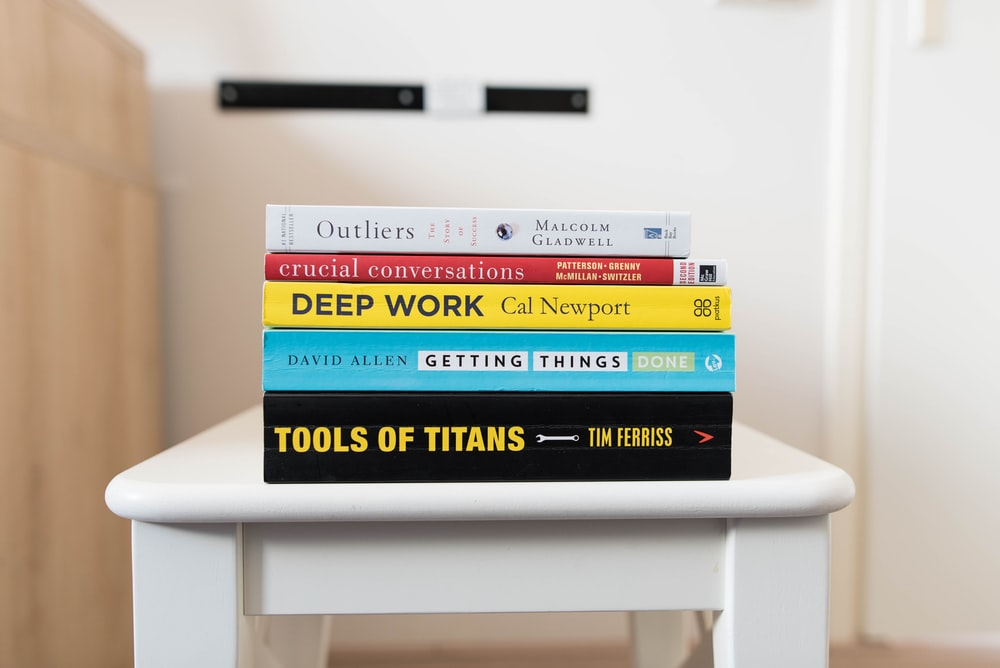 several books on top of table inside room