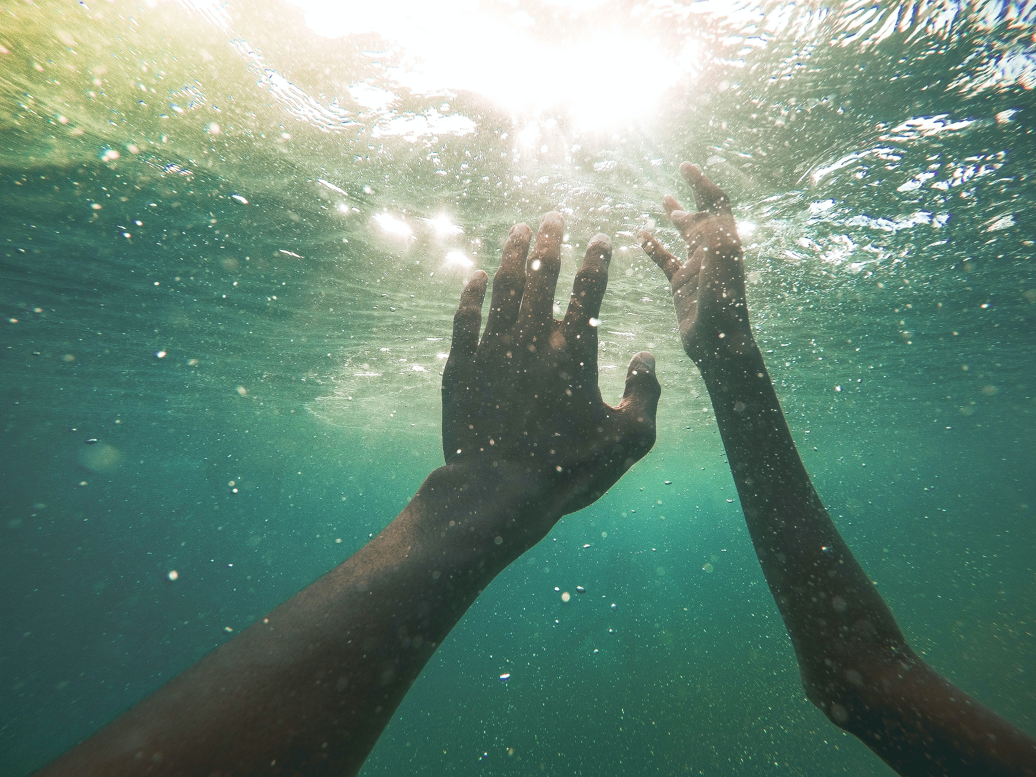 two persons underwater