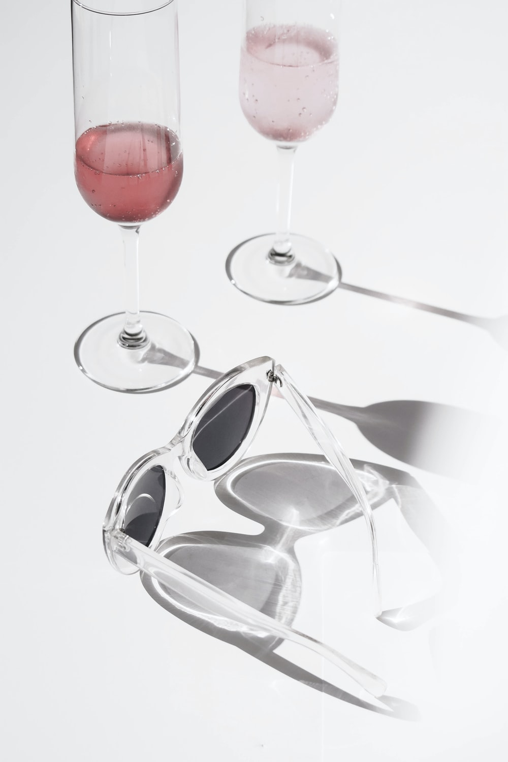 two clear footed drinking glasses photo