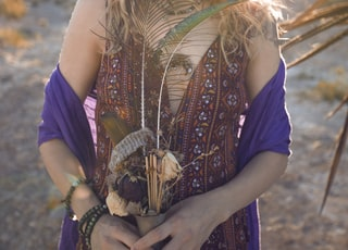 person holding flower vase