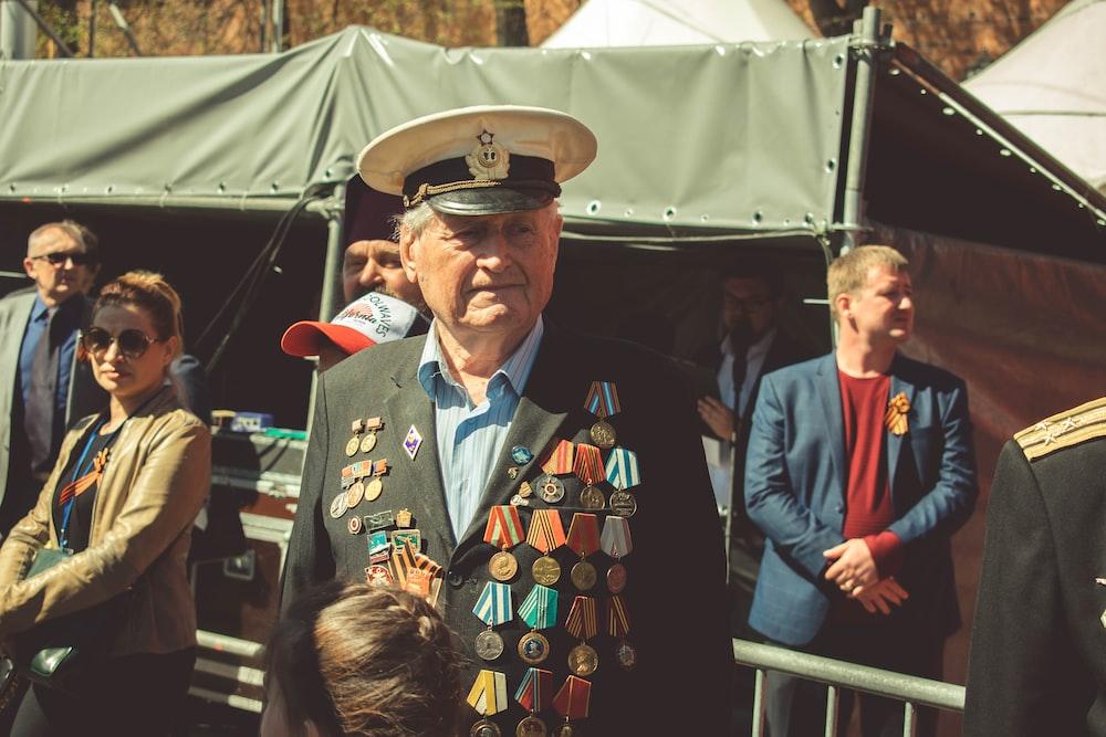 man standing near tent