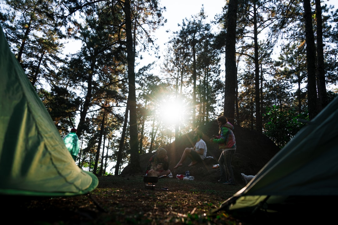 Three Friends Having Breakfast in Their Camping