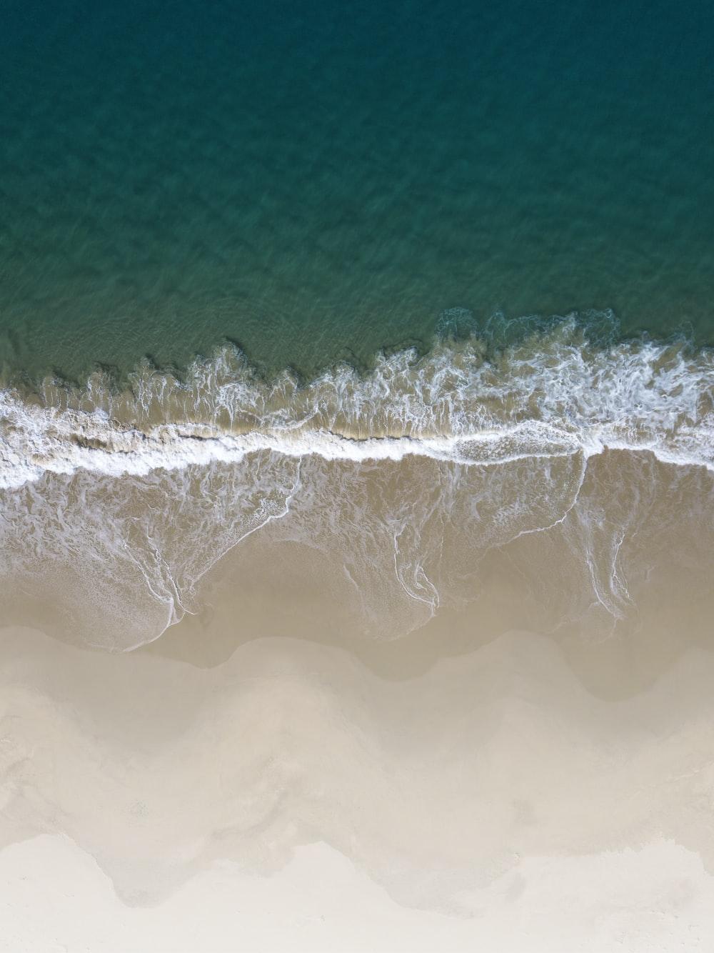 brown sand next to beach
