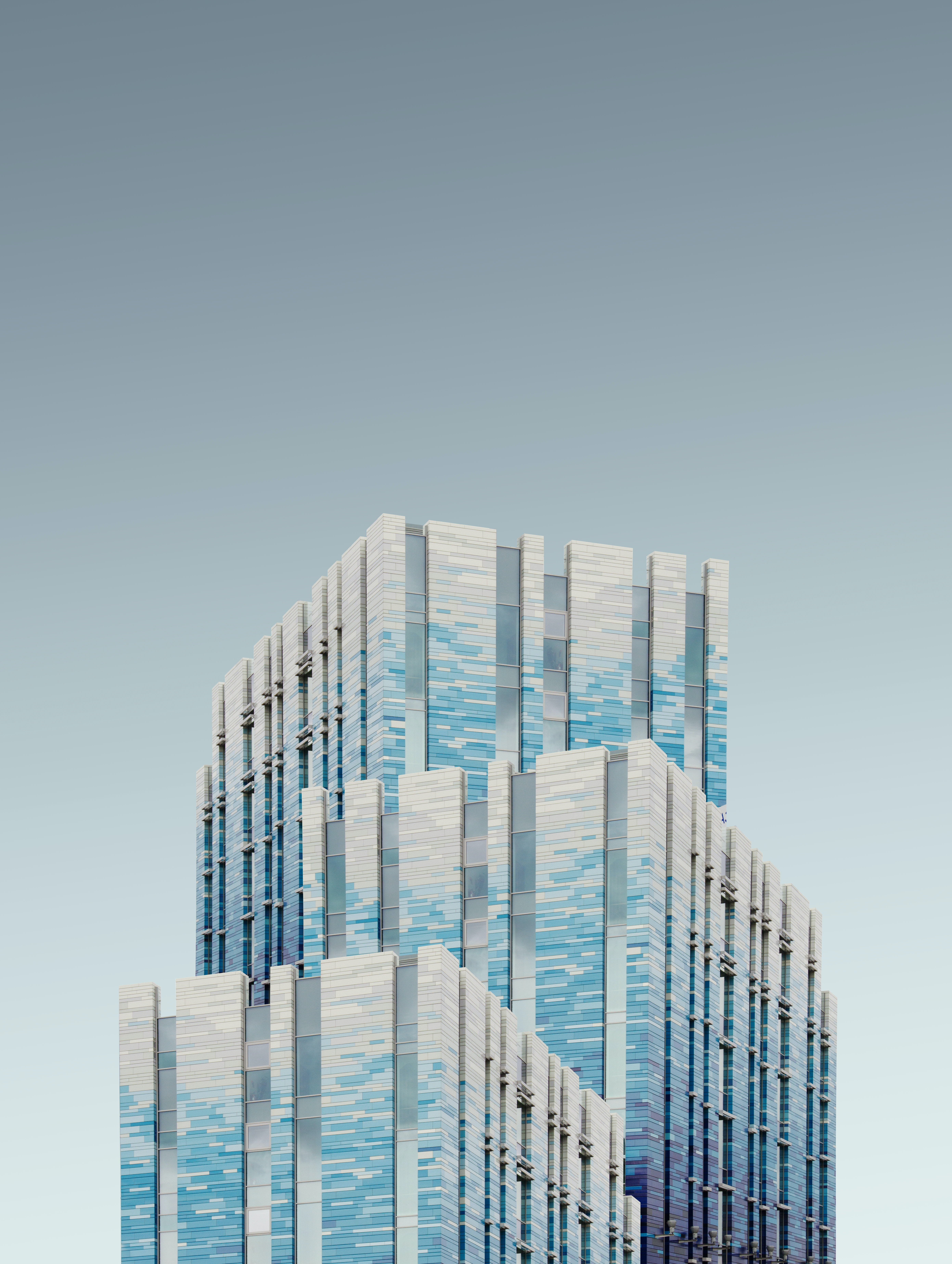 blue and silver high rise building under gray sky