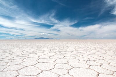 dry soil under white clouds and blue sky at daytime bolivia teams background