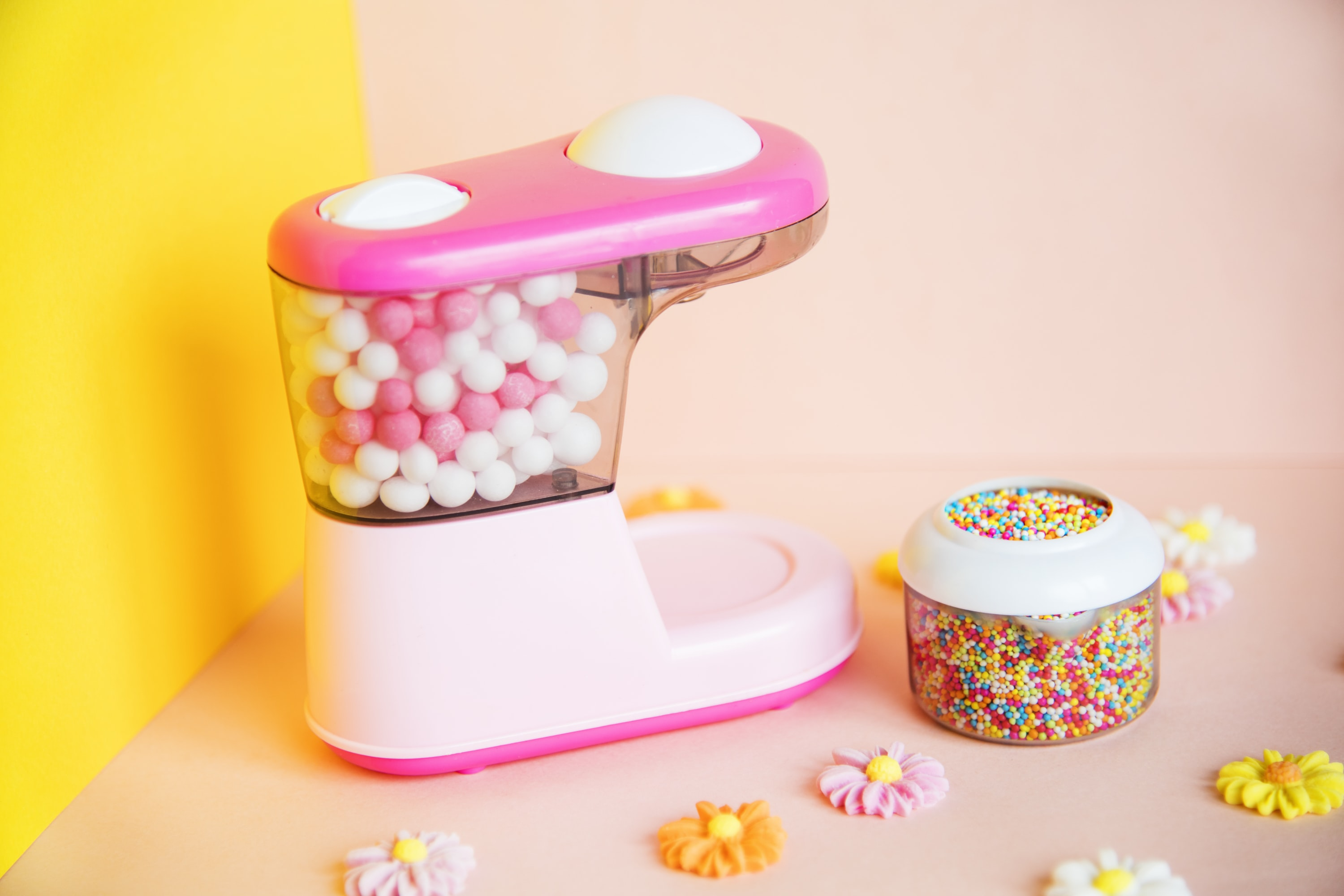 photography of candy dispenser fully filled with candies