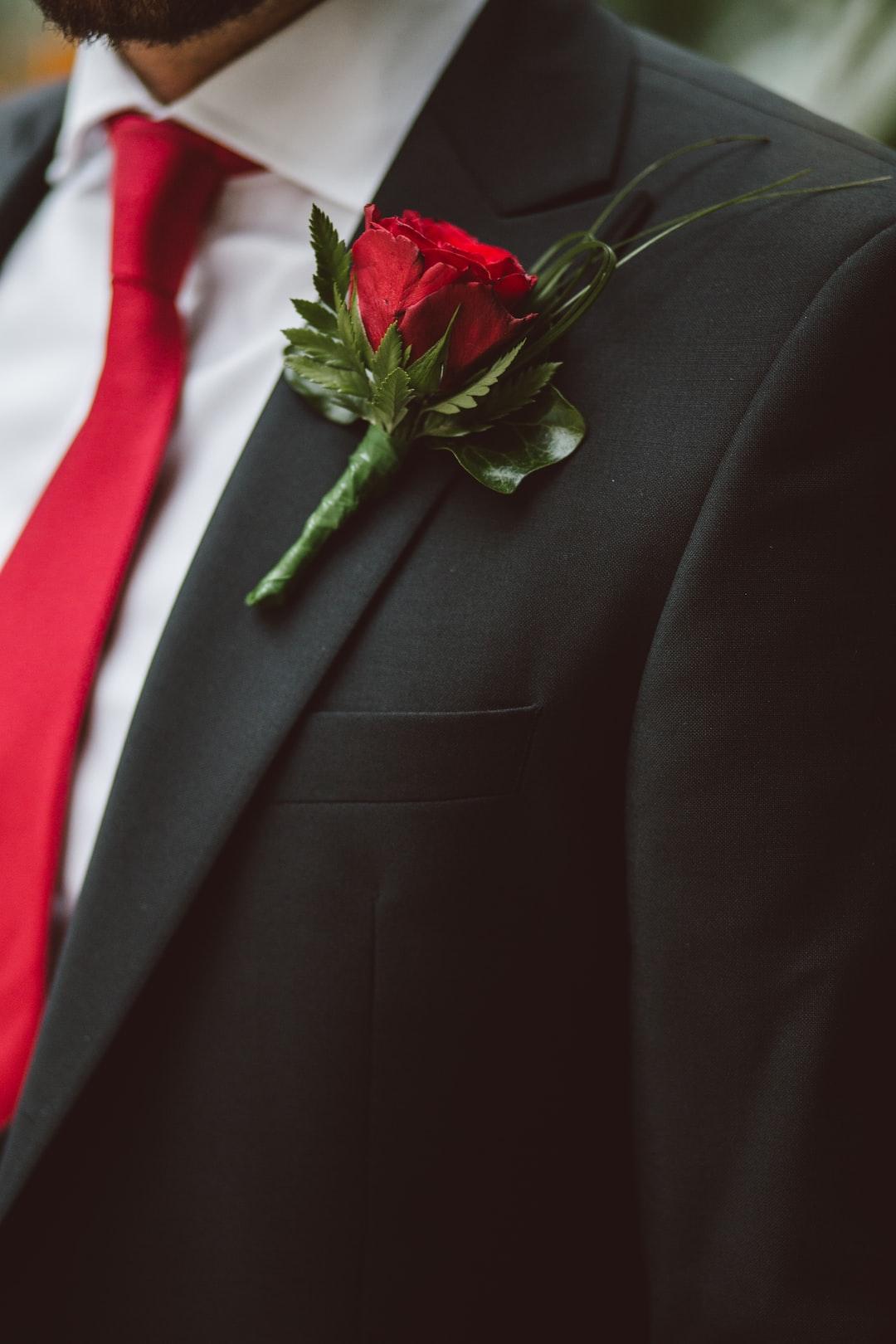 Groom wearing a red flower