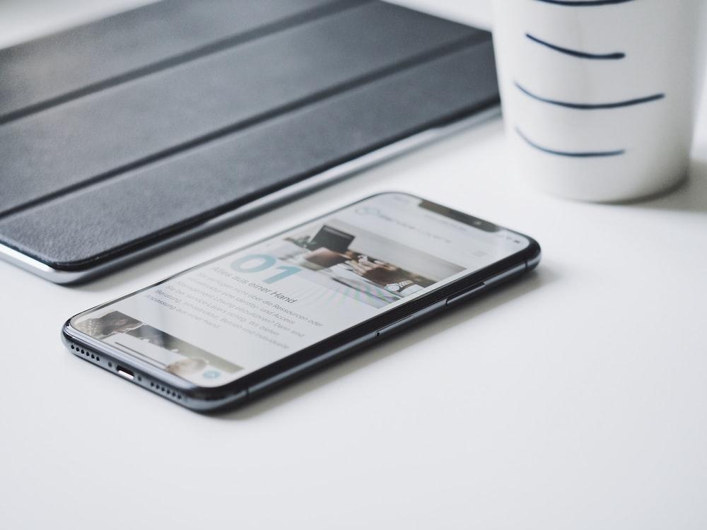 black smartphone beside black smart case