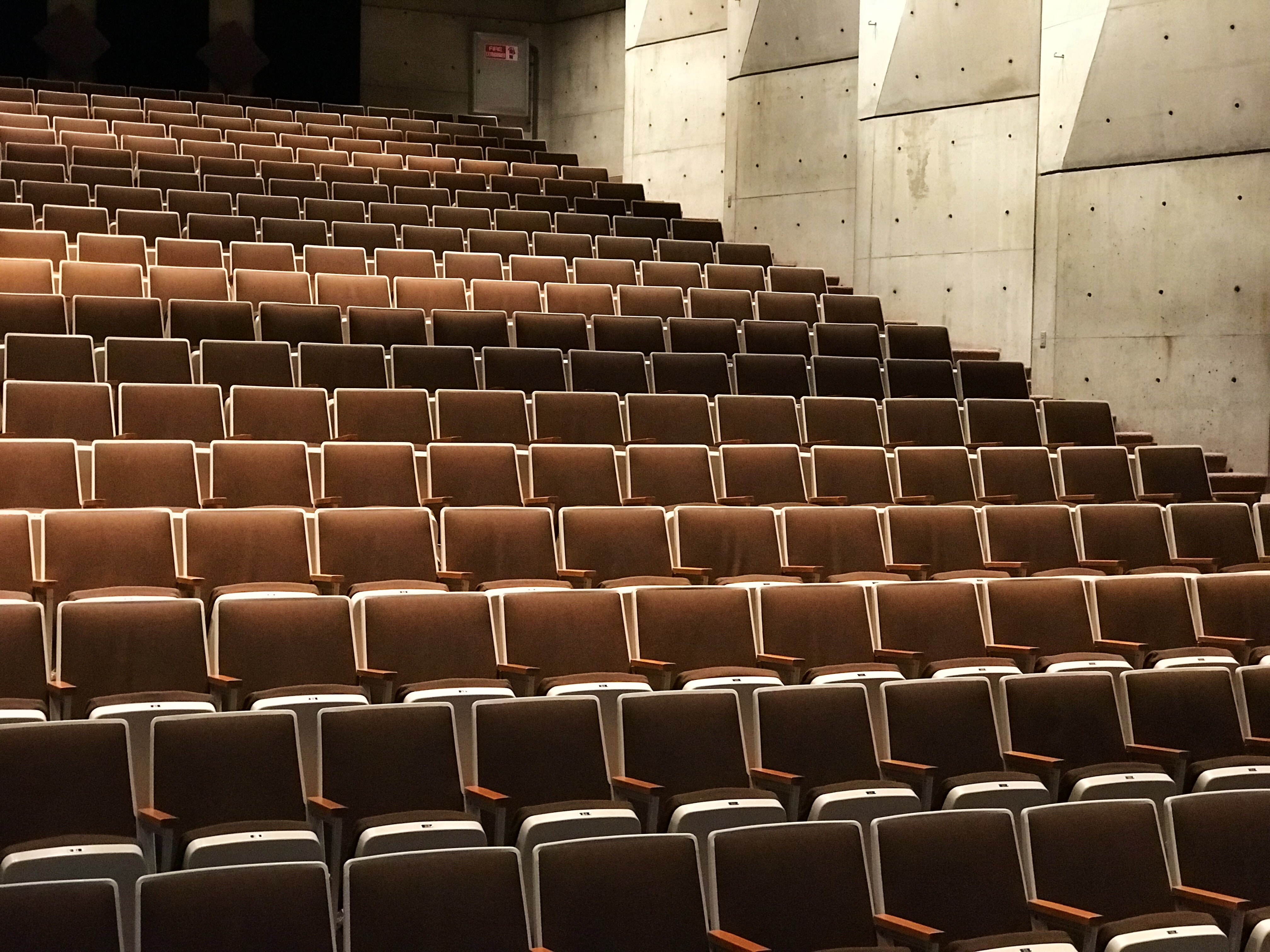 photography of theater chairs