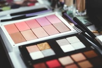 selective focus photography of makeup palette