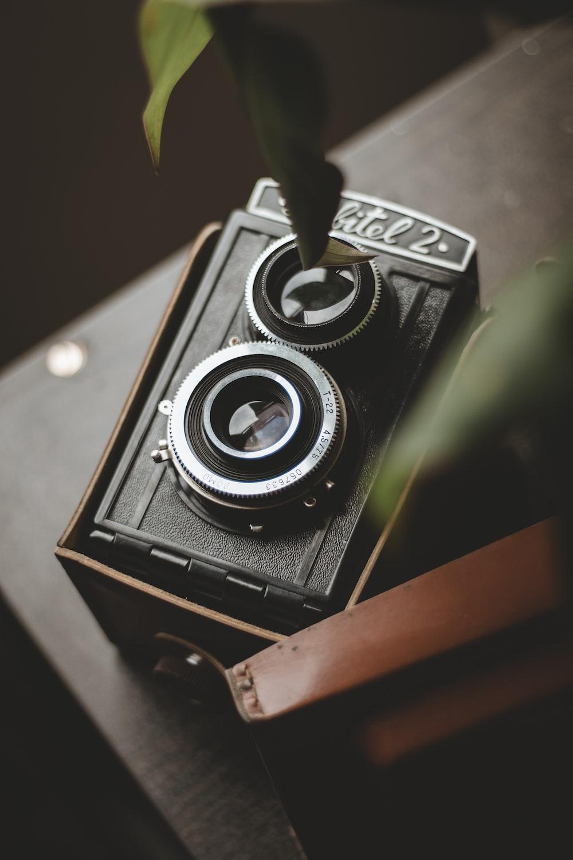 black box camera on brown panel