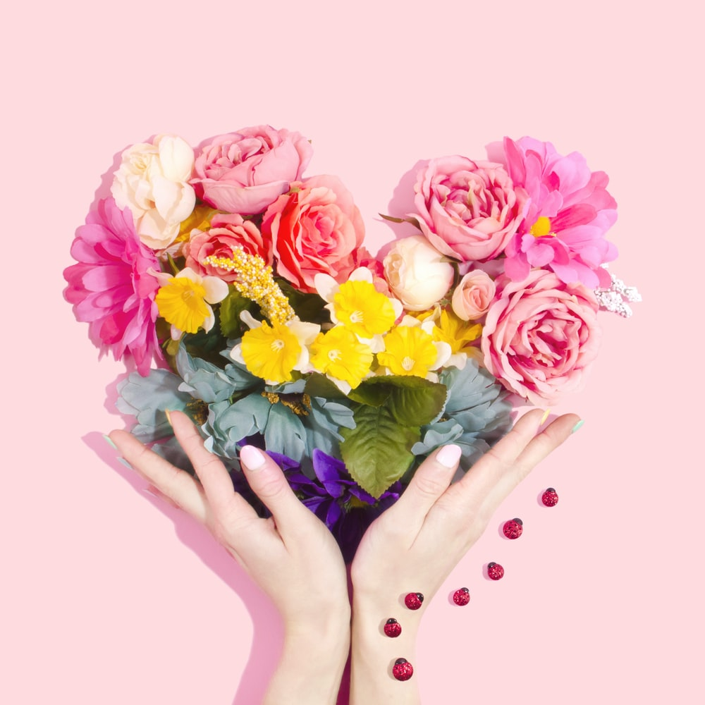 person holding bouquet of flower