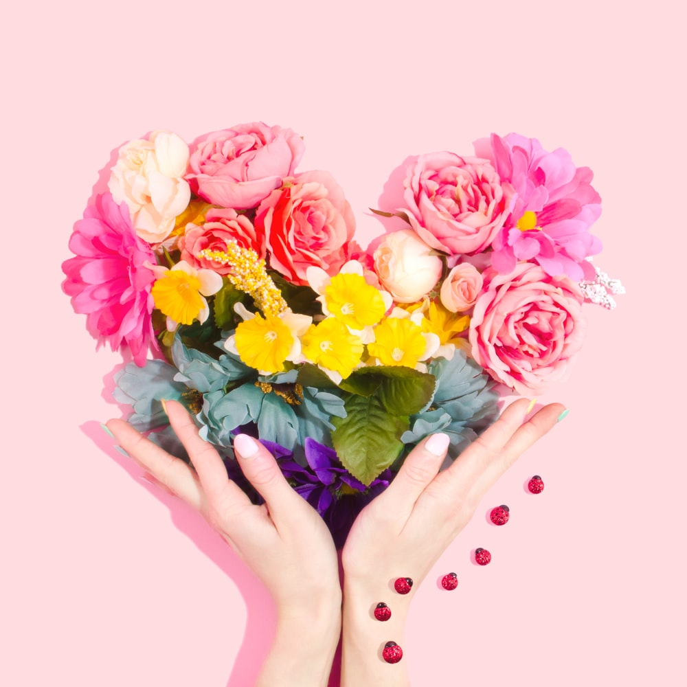 Rainbow flower heart photo by amy shamblen amyshamblen on unsplash person holding bouquet of flower izmirmasajfo