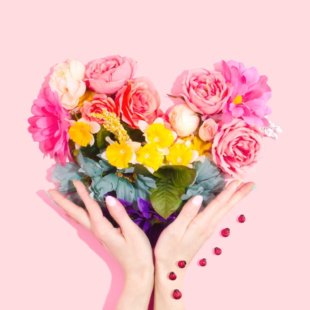 Rainbow flower heart photo by amy shamblen amyshamblen on unsplash person holding bouquet of flower mightylinksfo