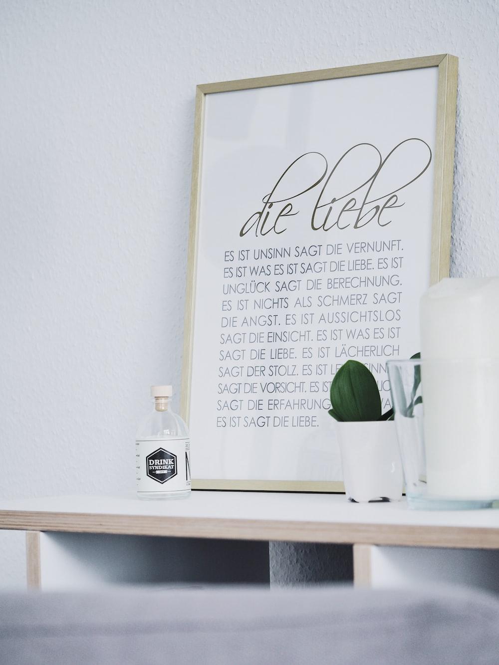 rectangular brown framed photo frame on white desk