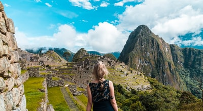 woman facing Machu Picchu