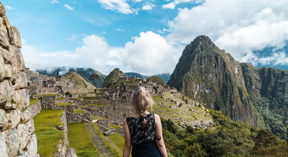 woman facing Machu Picchu