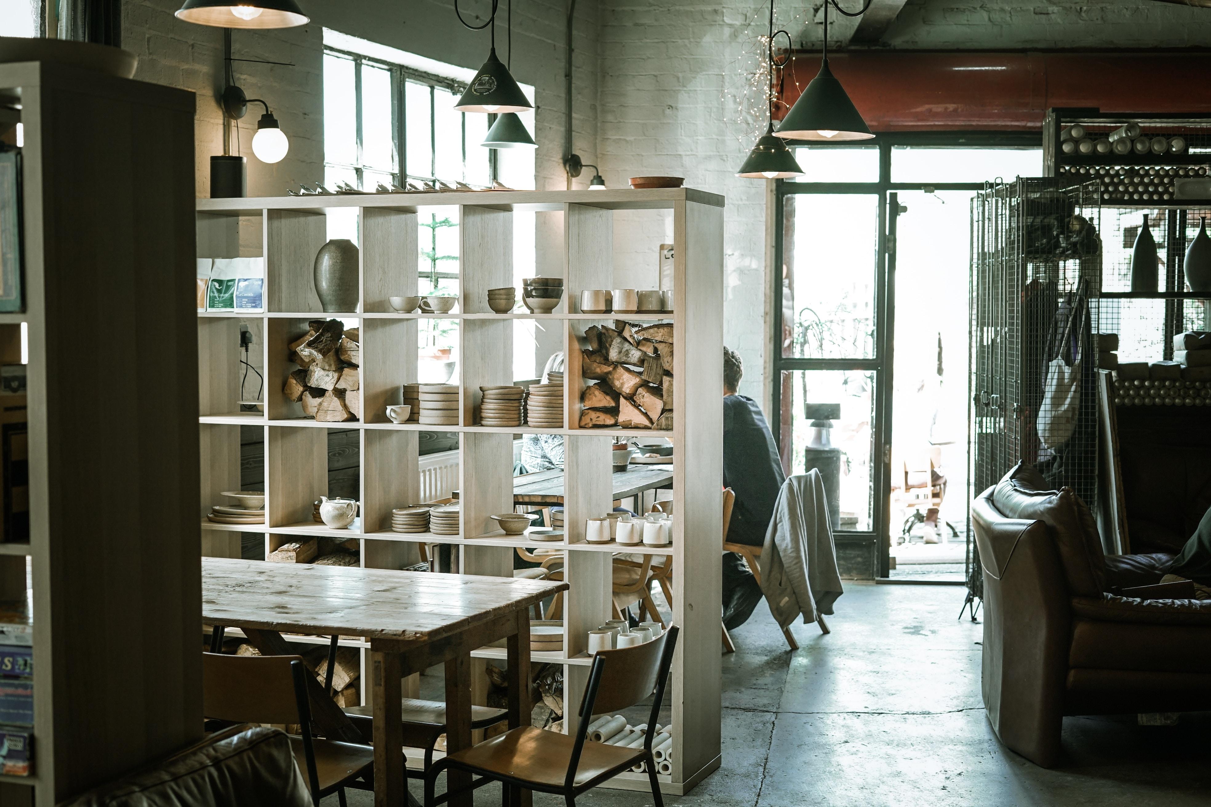 white wooden shelf near wooden table