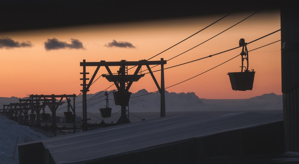 silhouette of cable car during sunset
