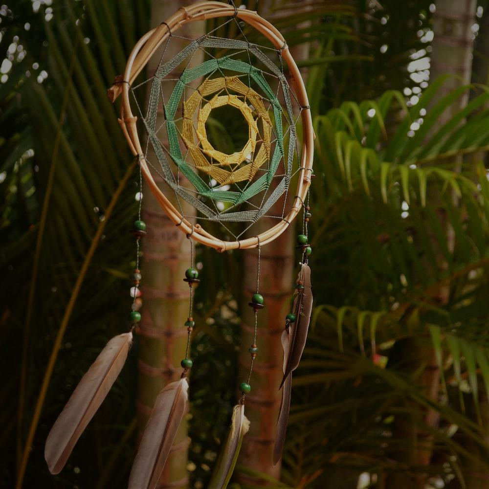 round brown and green haniging dreamcatcher