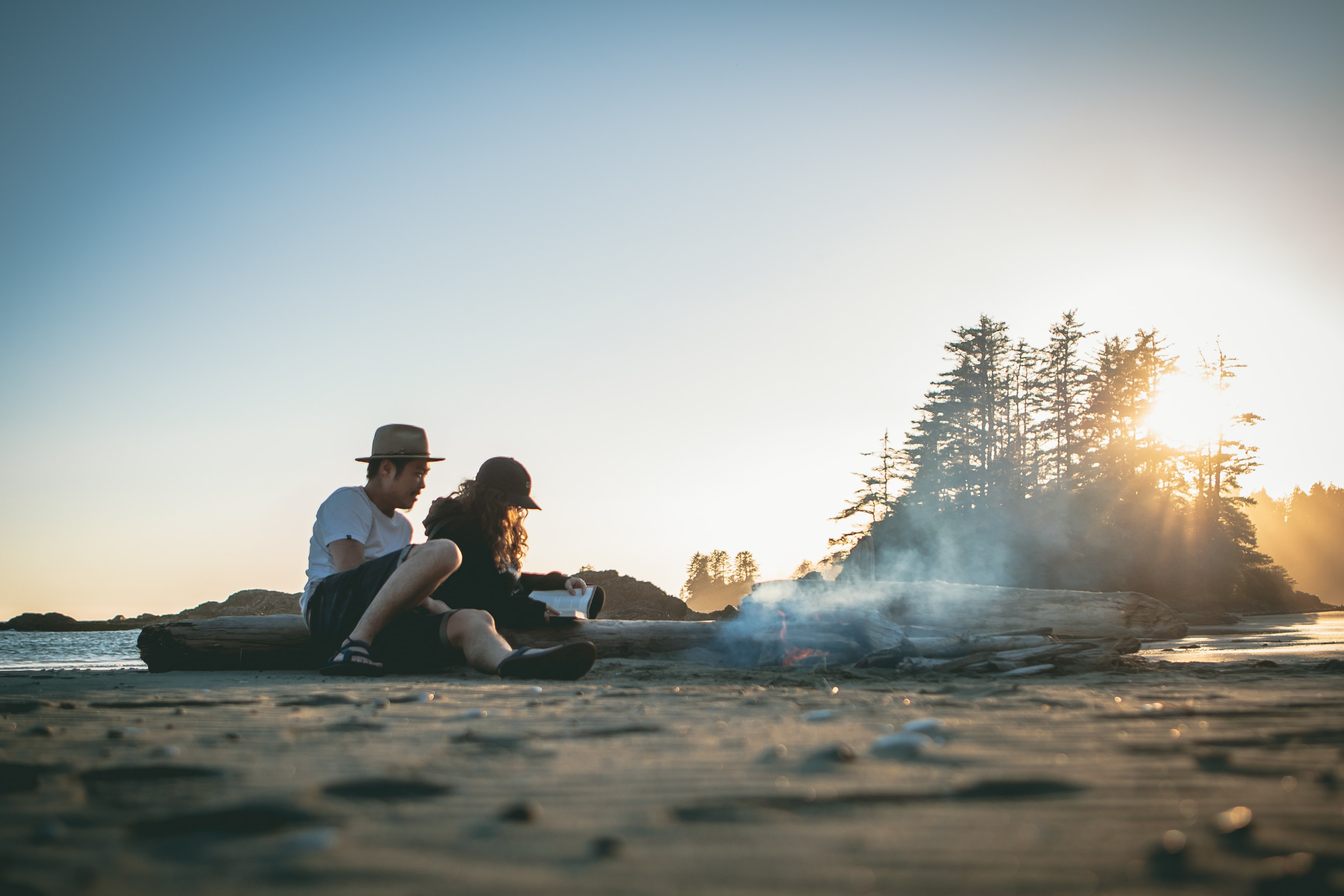man and woman near bonfire
