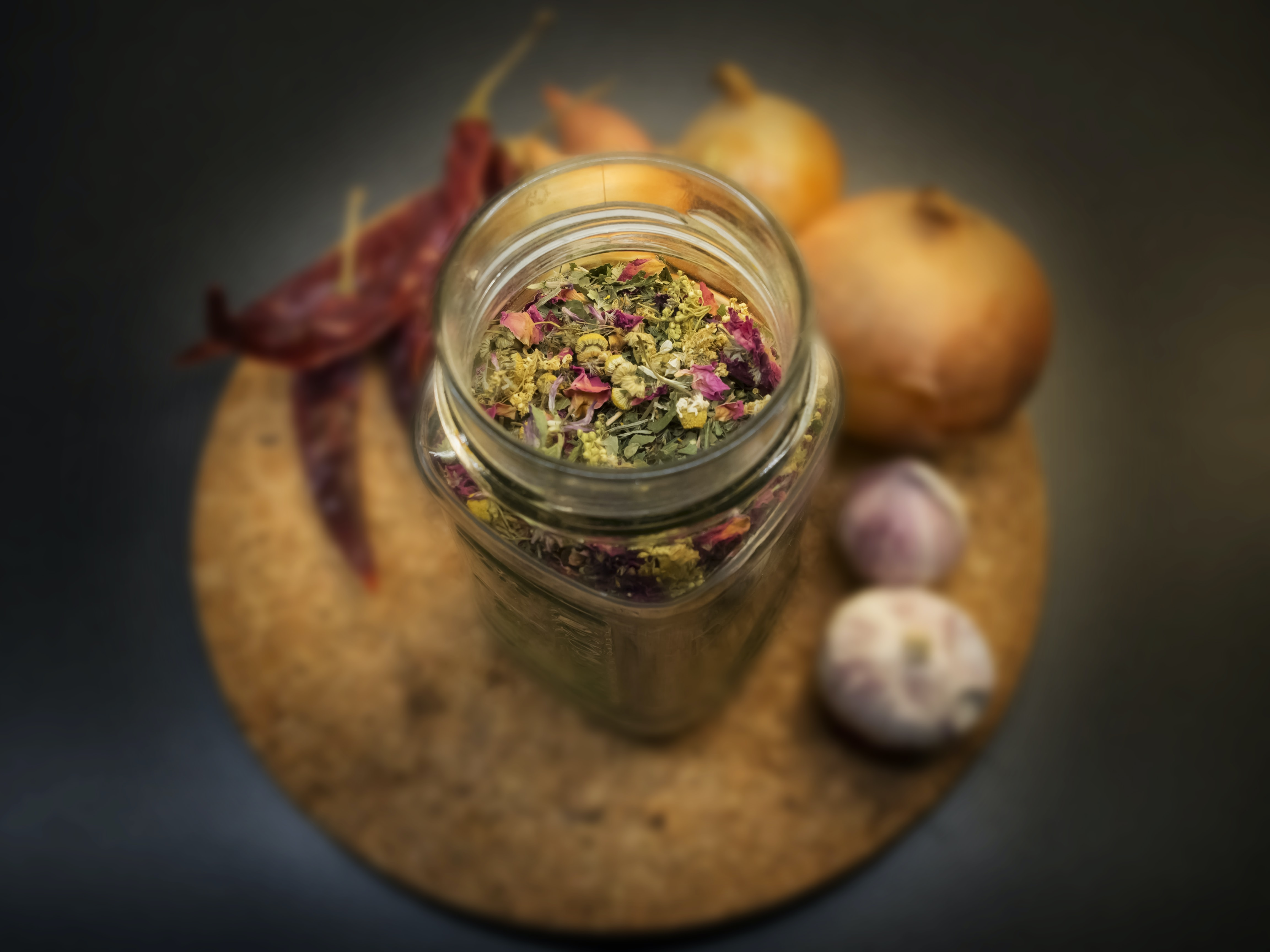clear glass jar filled with spices