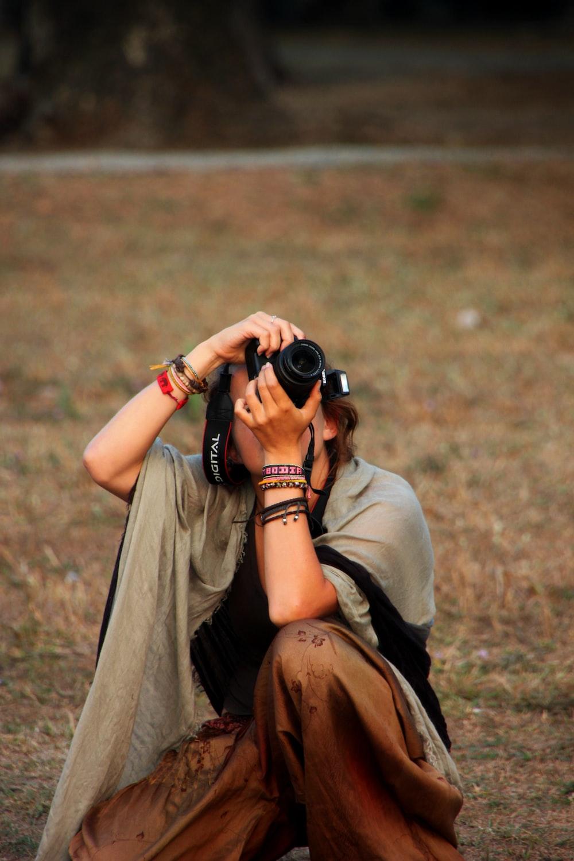 woman taking a photo using DSLR camera
