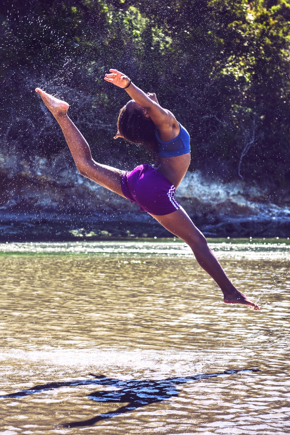 woman bending on body of water