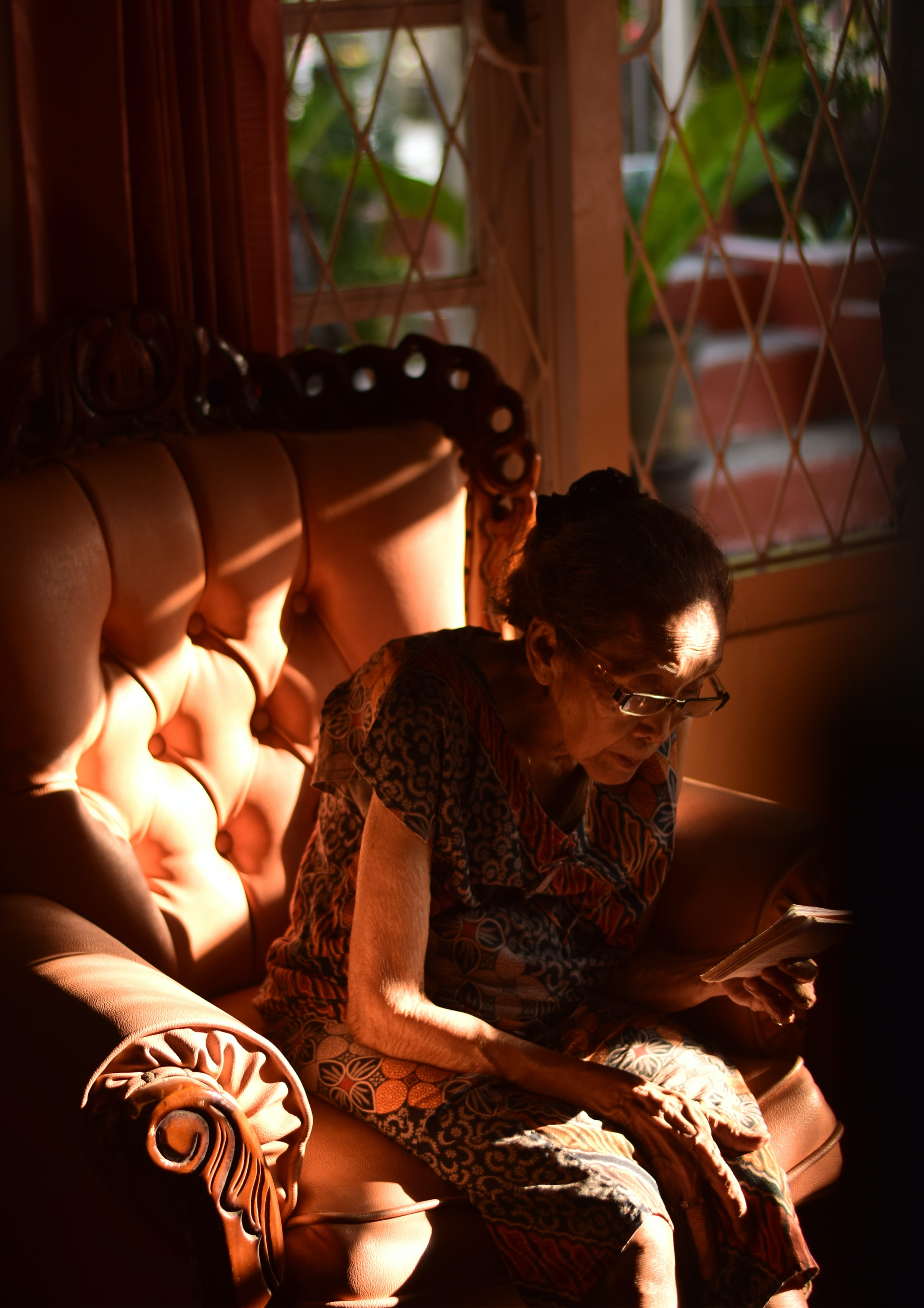 photography of sitting woman looking at papers