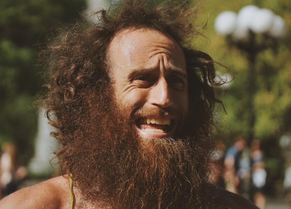 photo of man wearing beard and mustache