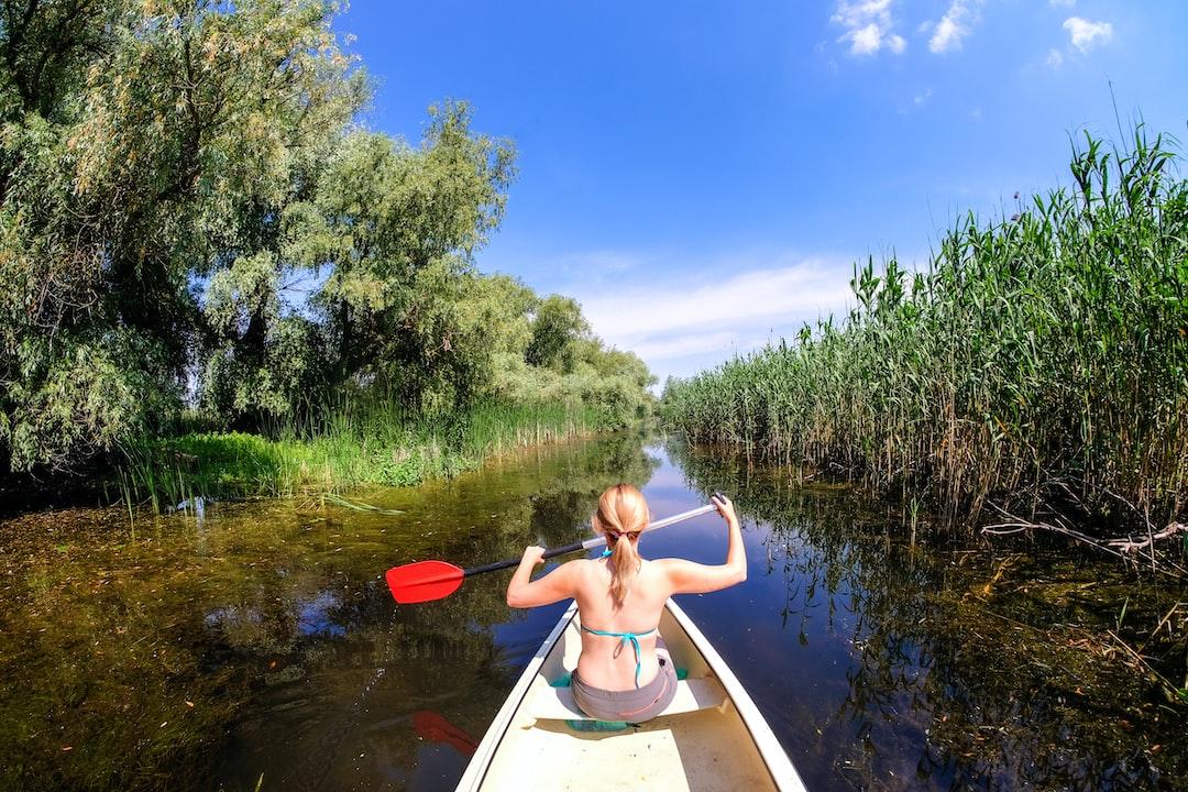 Woman Sailing in Danube Delta by Canoe Boat
