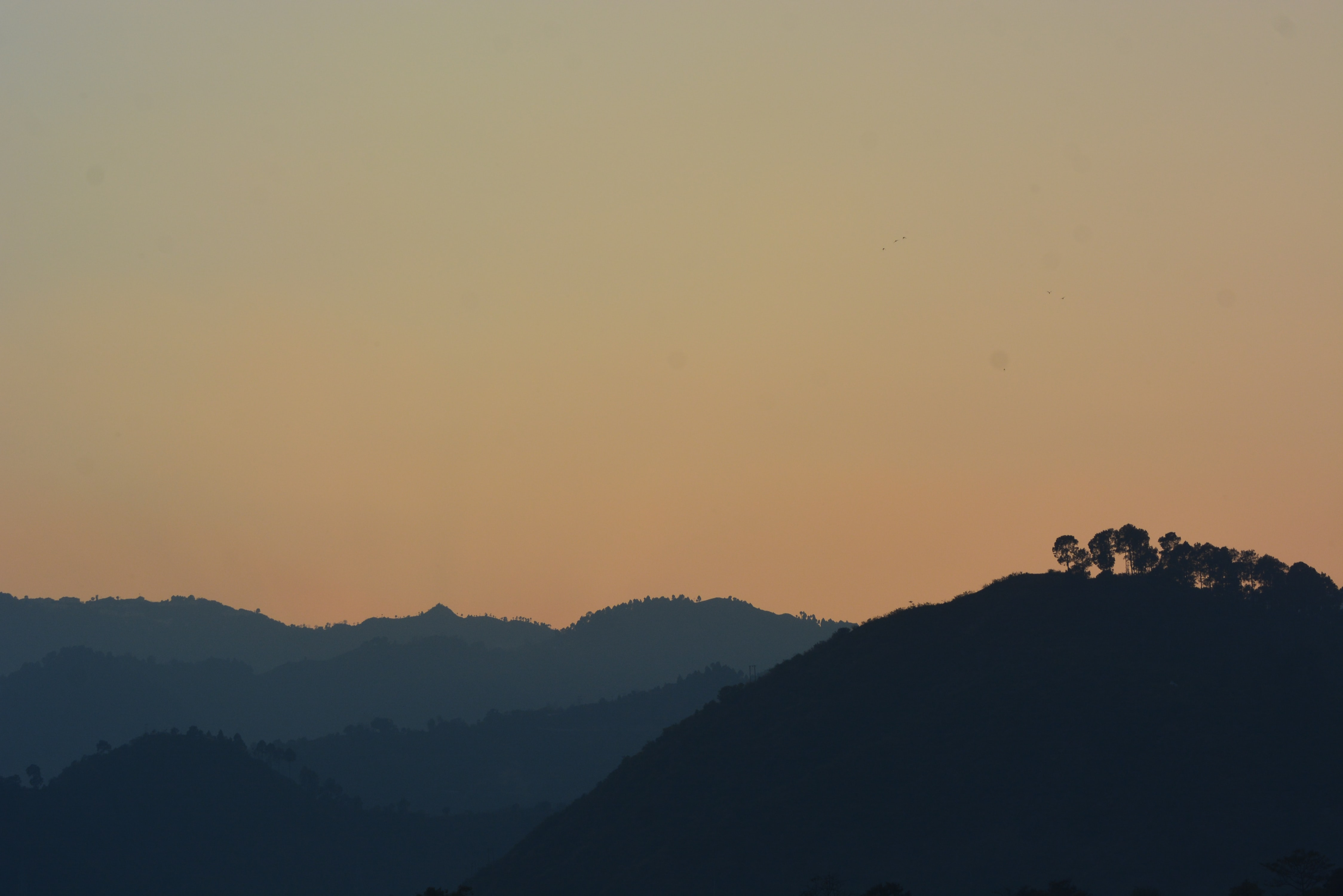silhouette of mountain at sunrise