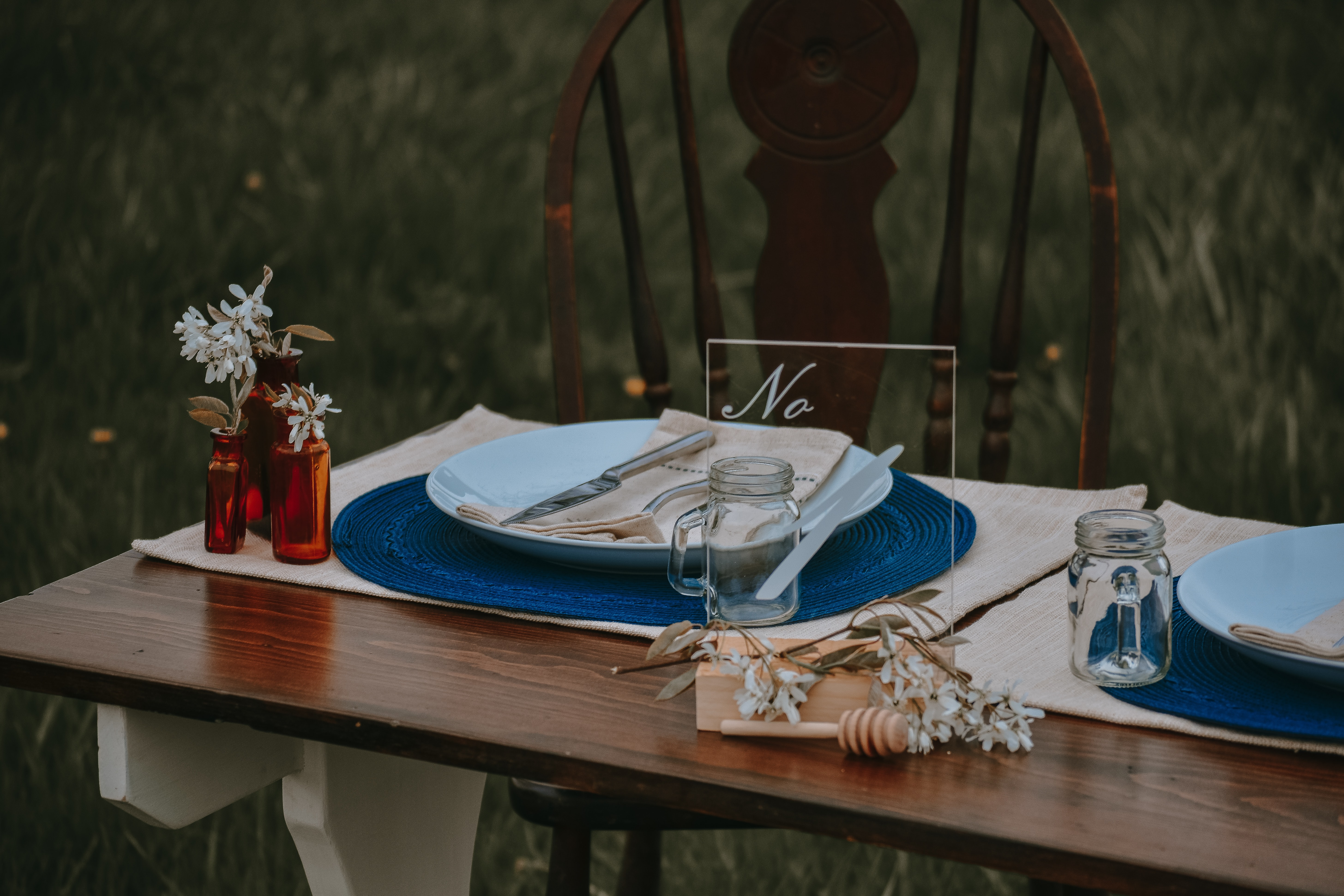 round ceramic table with silver spoon and fork