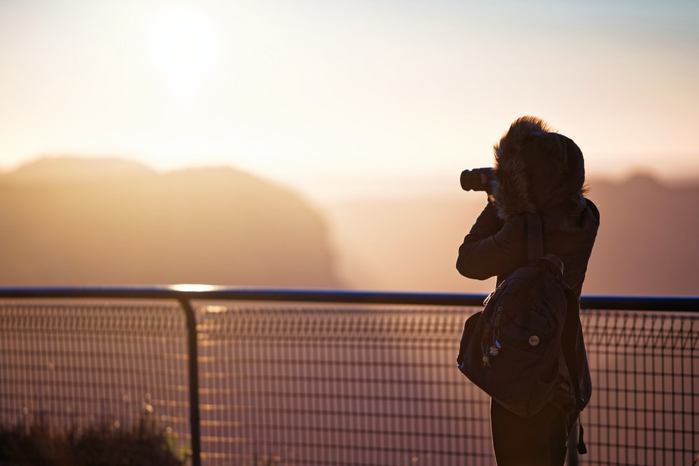 rule of thirds photography of person holding camera