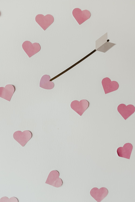 gray arrow in pink heart illustration