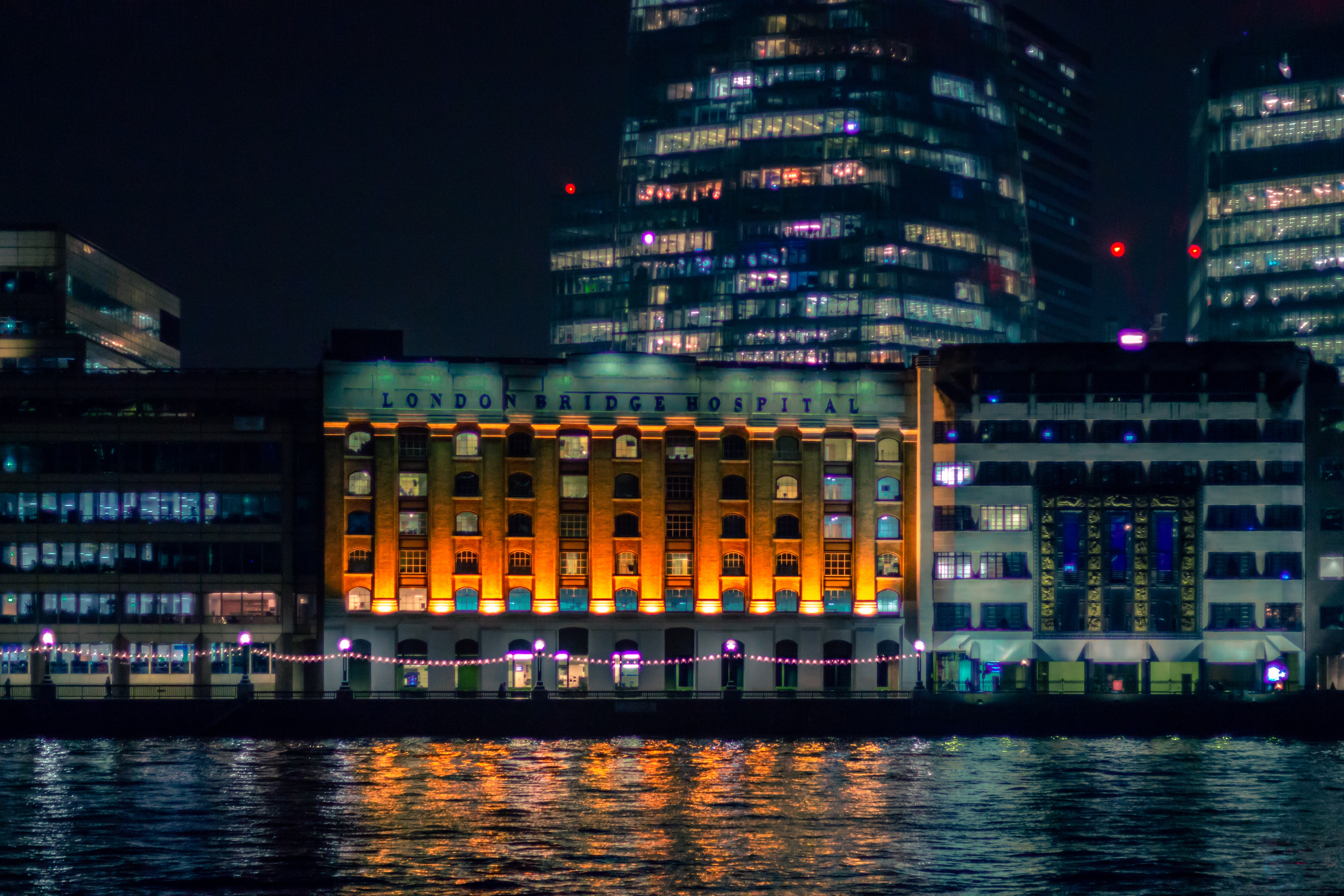 landscape photography of cityscape near body of water
