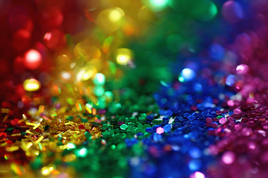 Whimsical and colorful rainbow glitter background perfect for celebrating the LGBTQIA community and gay pride 2018.