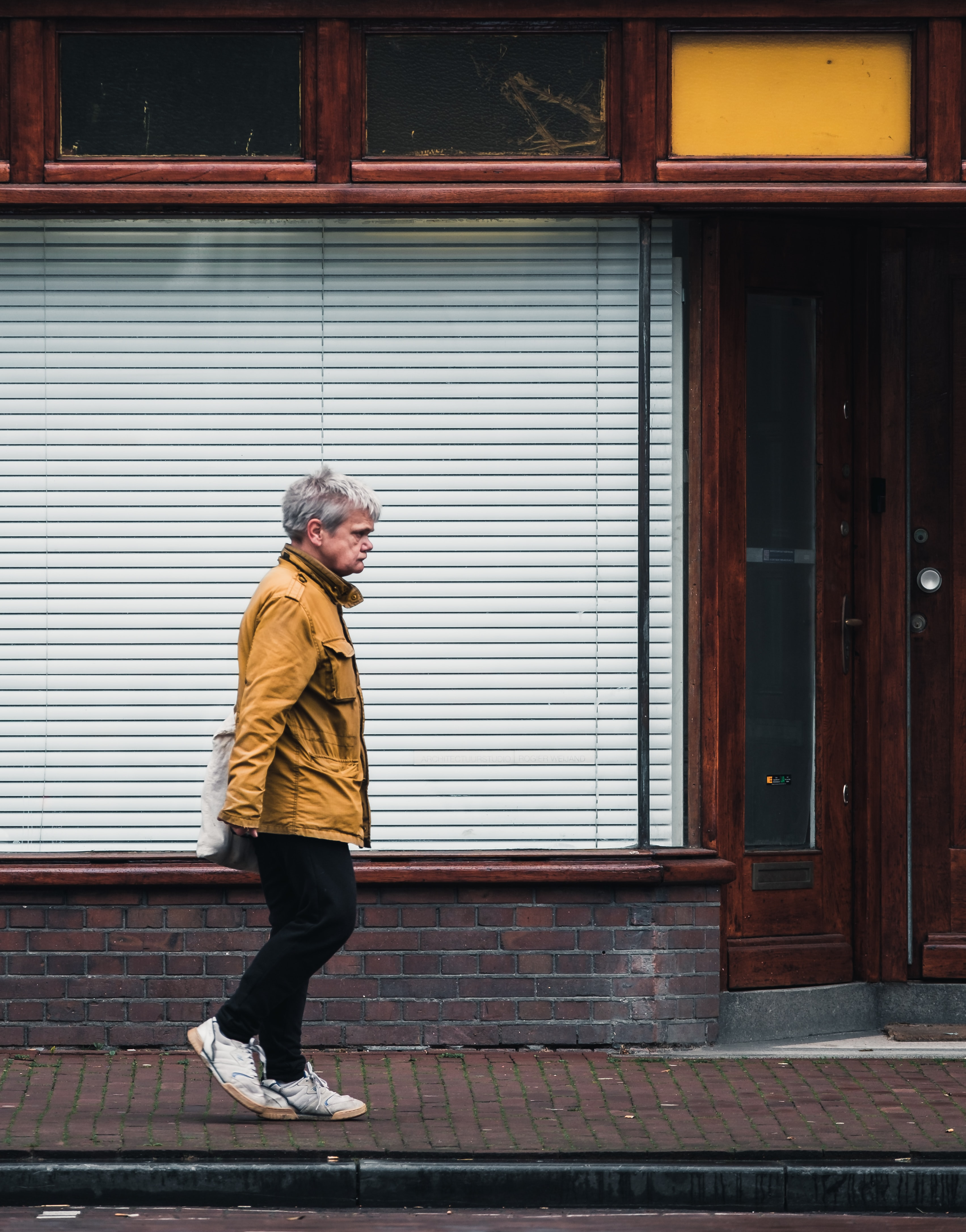man walking in front of store