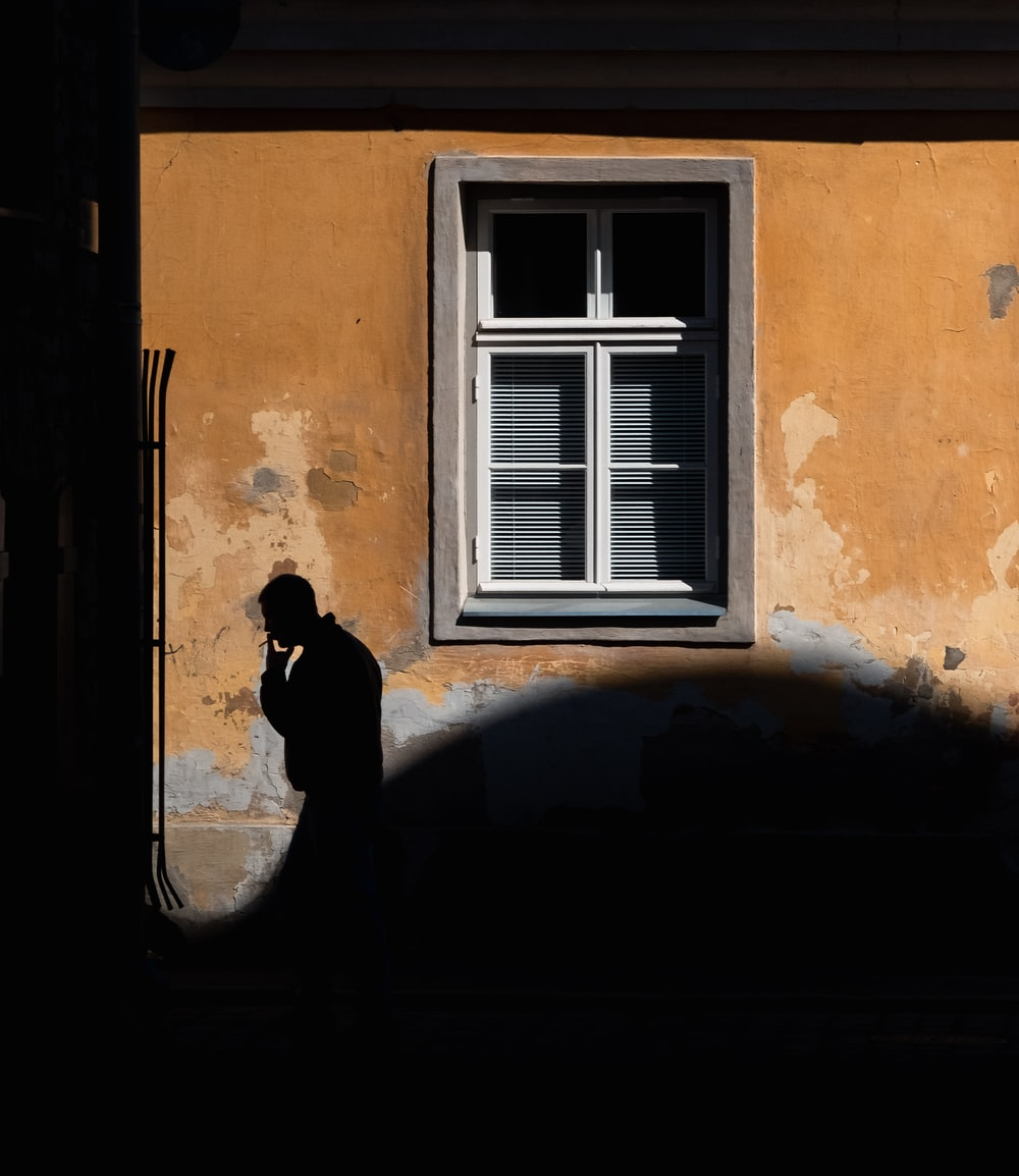 man passing by the window