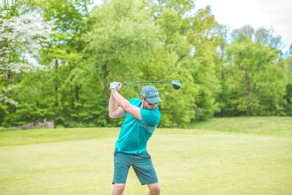 man striking golf ball
