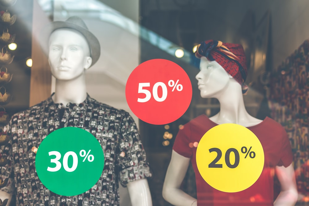 two male and female mannequin wearing clothes