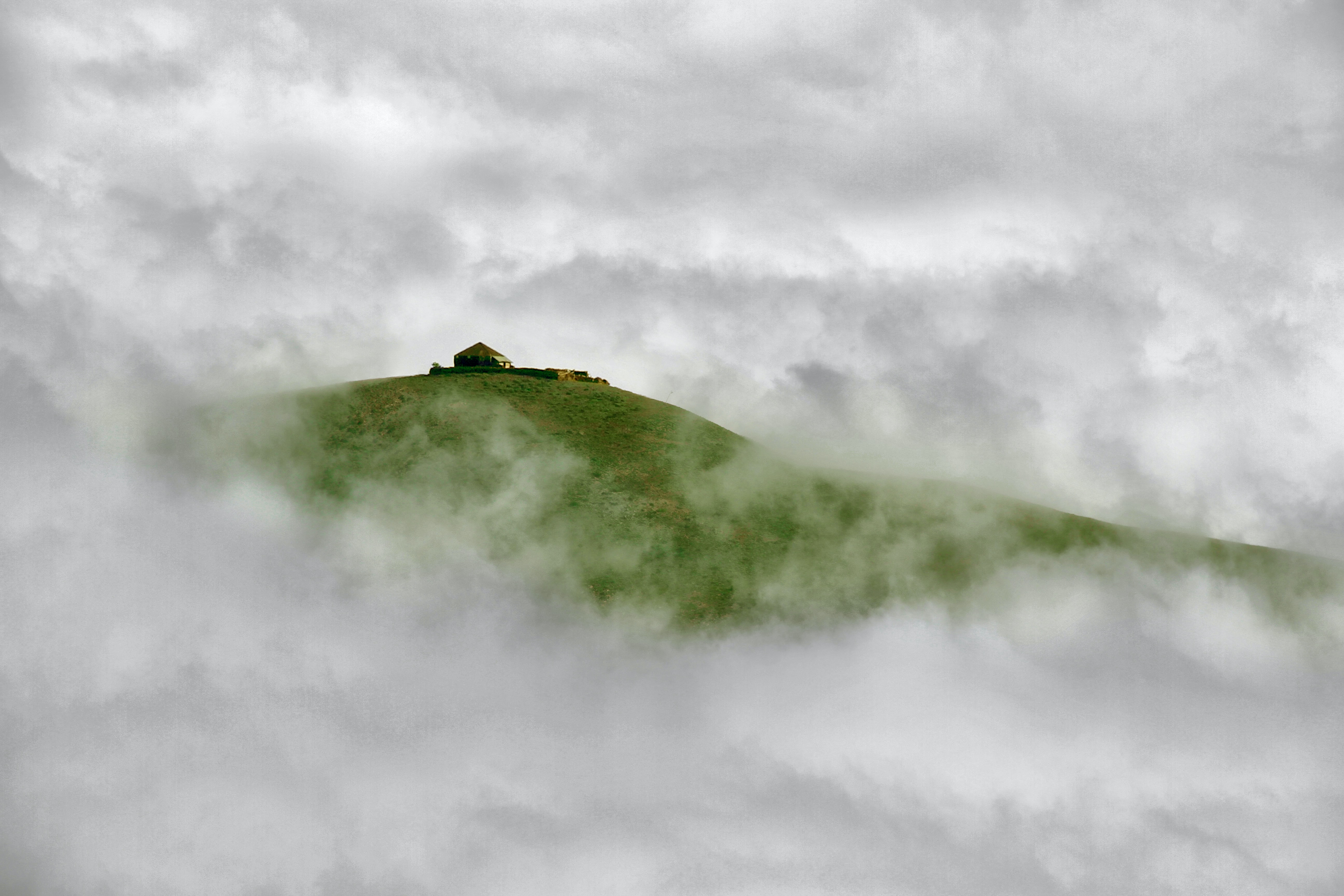 mountain covered with clouds during daytime