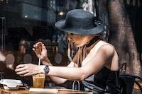 woman in black bucket hat