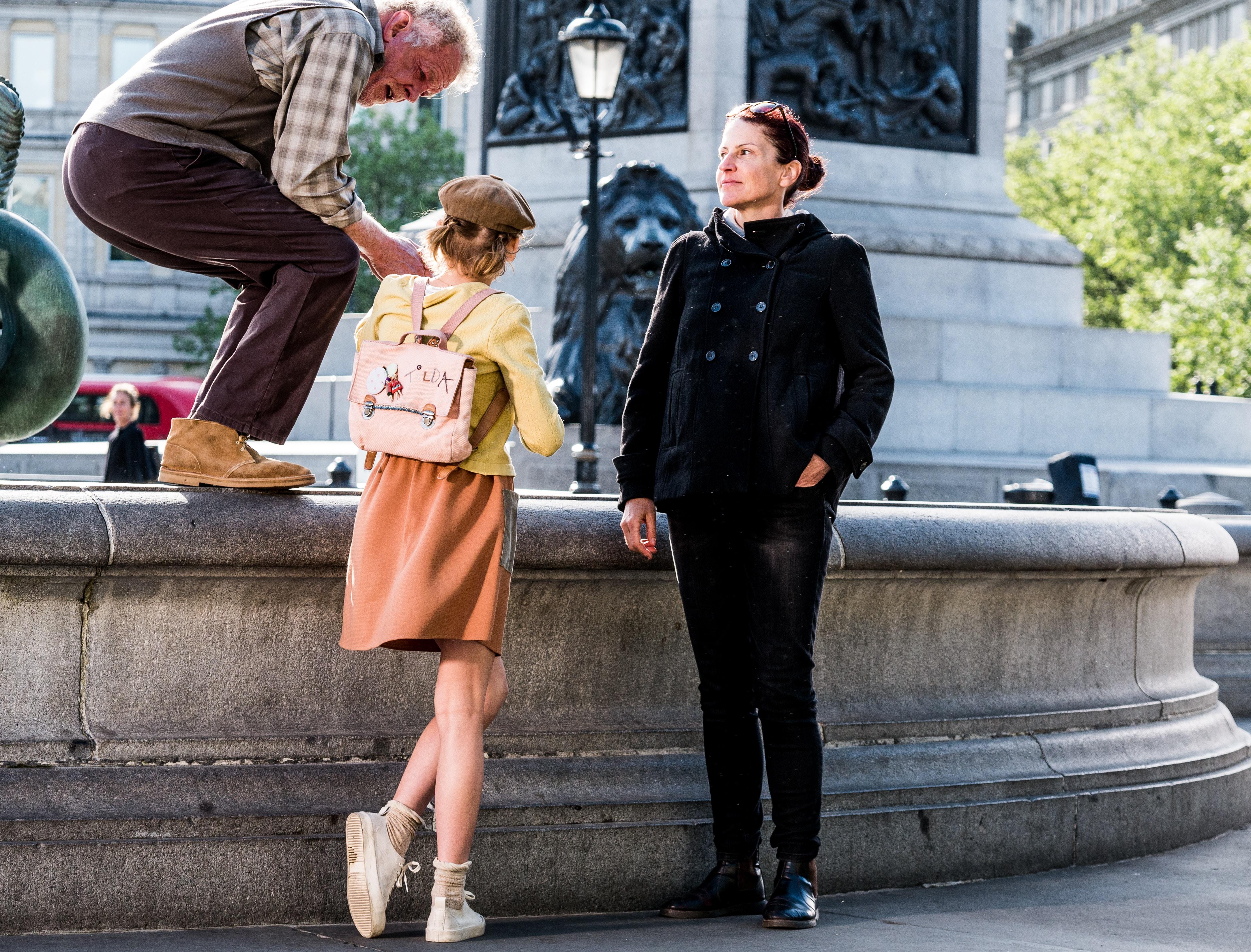 woman standing near city fountain