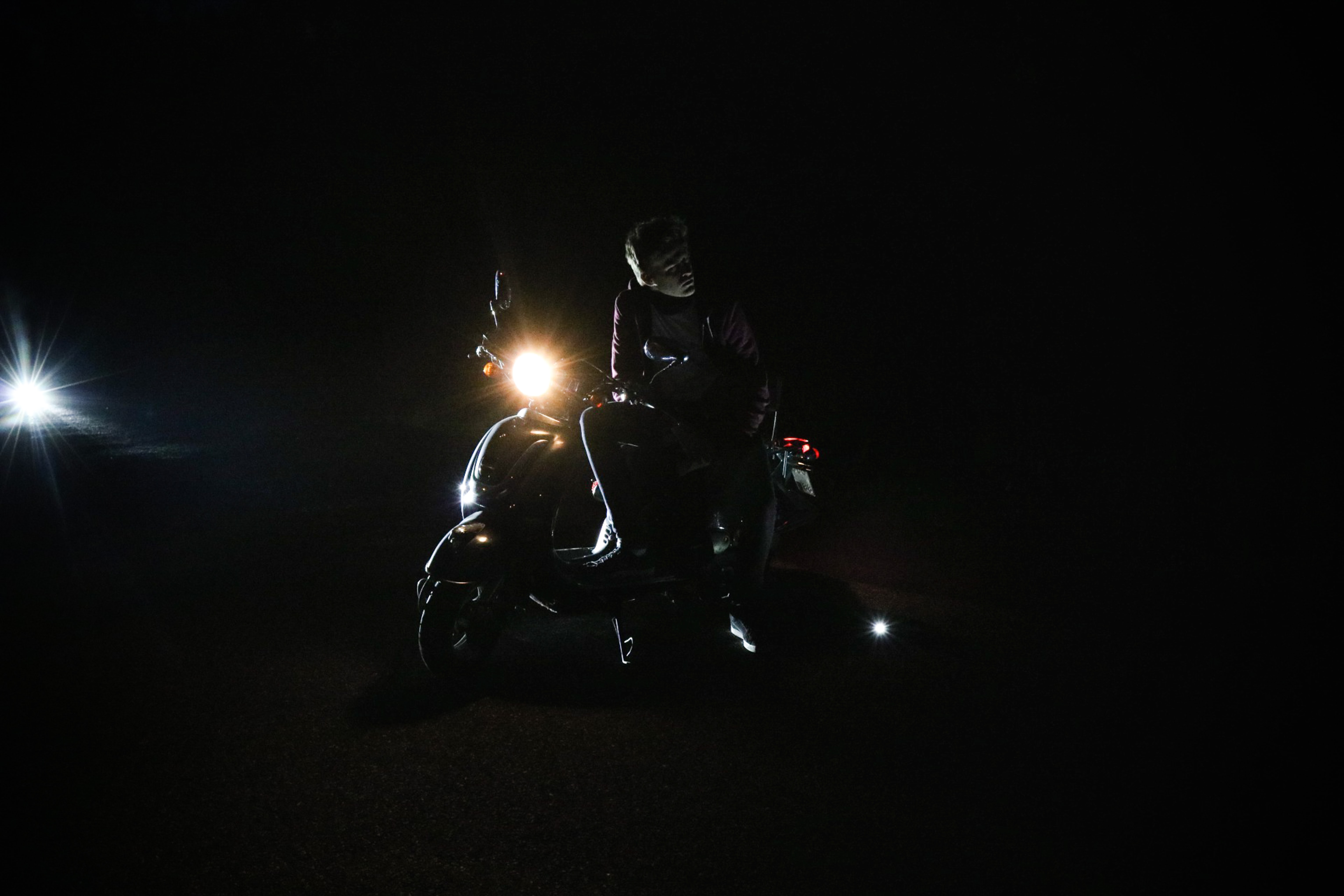 person sitting on motorcycle
