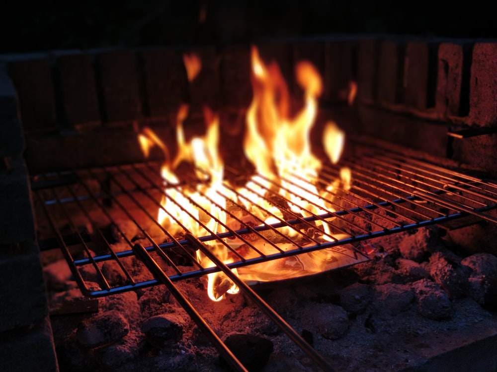 closeup photo of bonfire grill grilling avocados