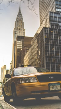 yellow Ford taxi parked near Chrysler building