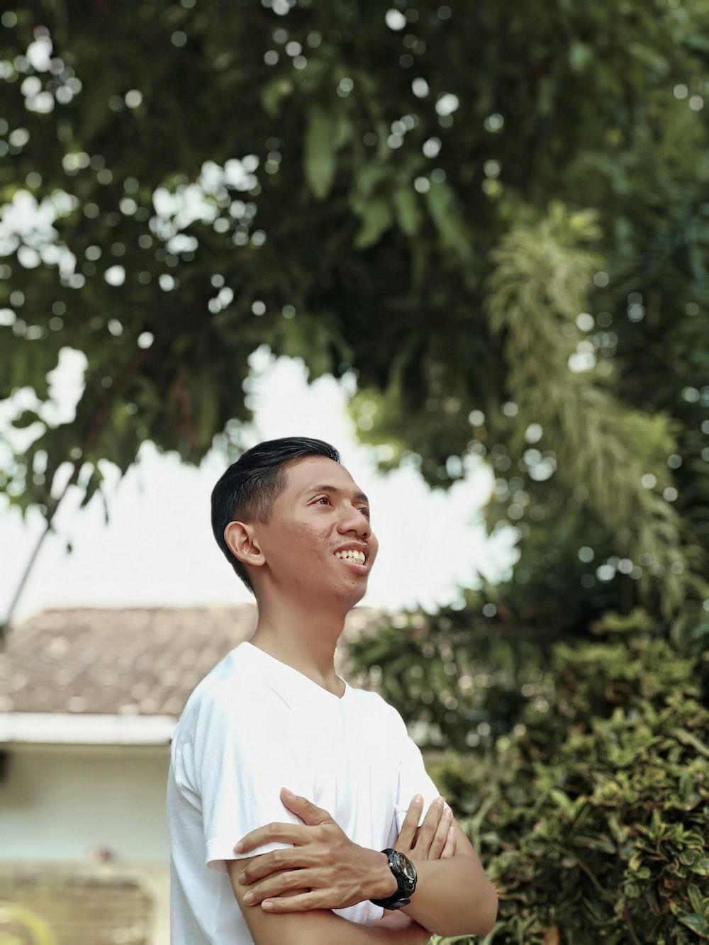 men wearing white shirt near trees