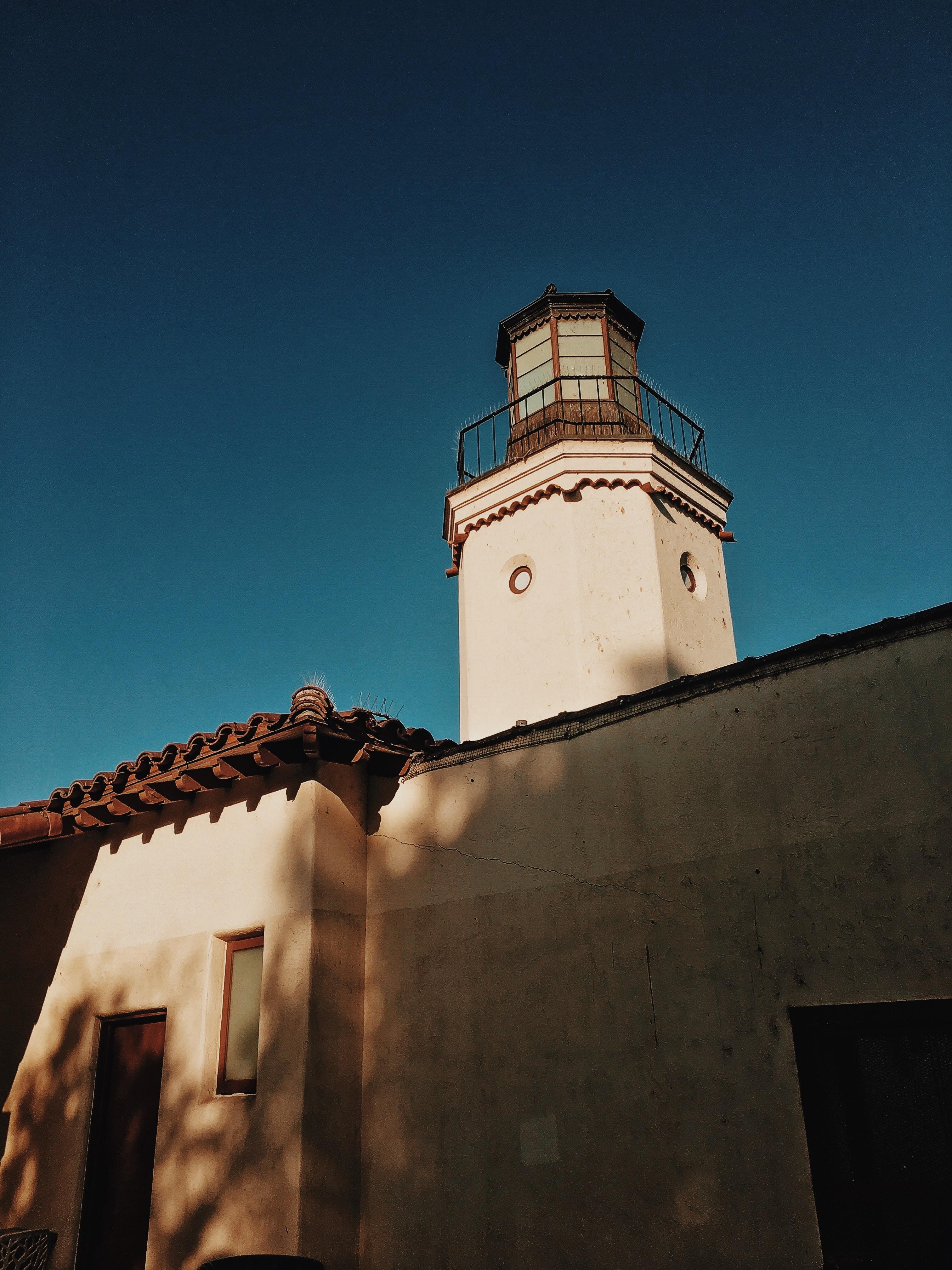 white concrete tower under blue sky